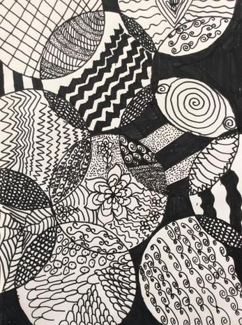 Zentangle designs exploring the calming effects of repetitive pattern