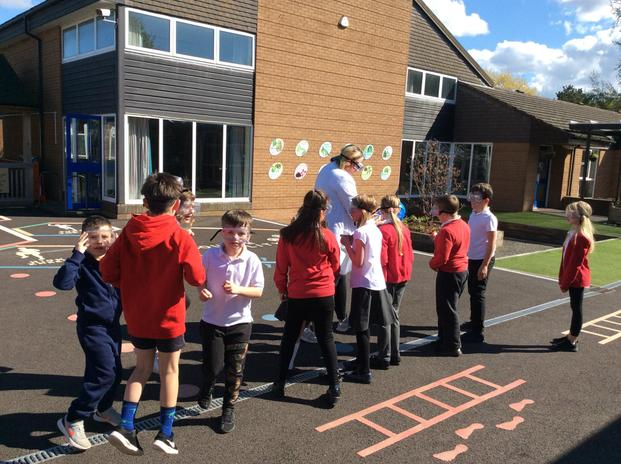 The children get involved in practical science activities.