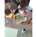 Eloise enjoyed making bubbles with her brother