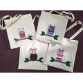 Owl weavings sewn onto tote bags