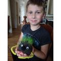 Tomas has made a grass head!