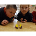 Cutting play doh into equal groups