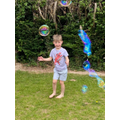 George tried catching bubbles in the garden