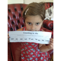 Viktoria practiced counting in 10's...