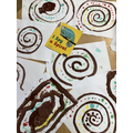 We explored snail patterns using finger paints and brushes.