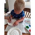 He traced a swirly pattern...