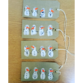 Fingerprint snowmen gift tags