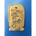 Clay cartouche using hieroglyphics to spell names