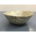 Paper mache bowls using pages from a recyled novel