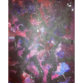 Galaxies created by sponge and flick painting