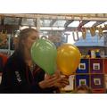 The orange balloon had helium in