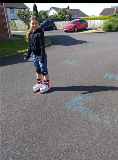 Julia is practising her compass points outside