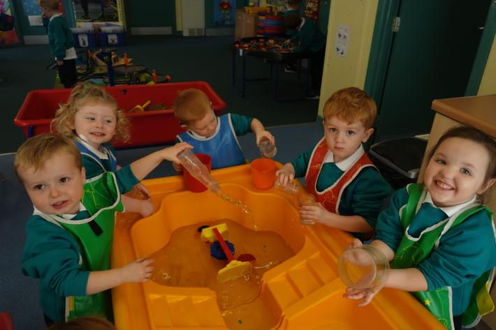 We learn to share our play space and toys.