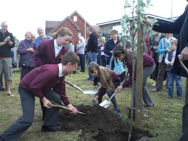 Children planting the Jubilee tree.
