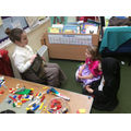 Young Y3 'Miss' reading to the Y1 pupils.