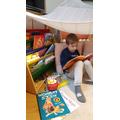 Reading in my den