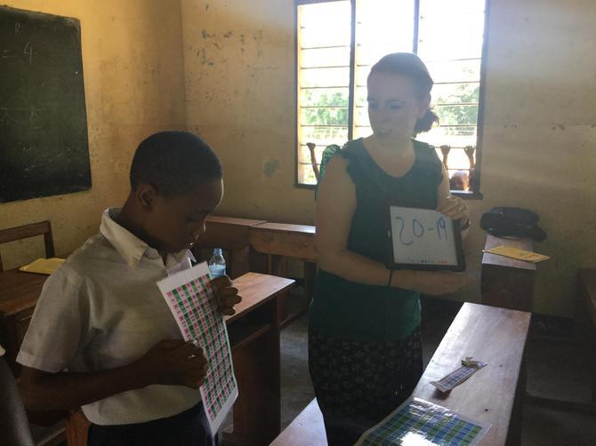 Mrs Allen helping a child learn Maths