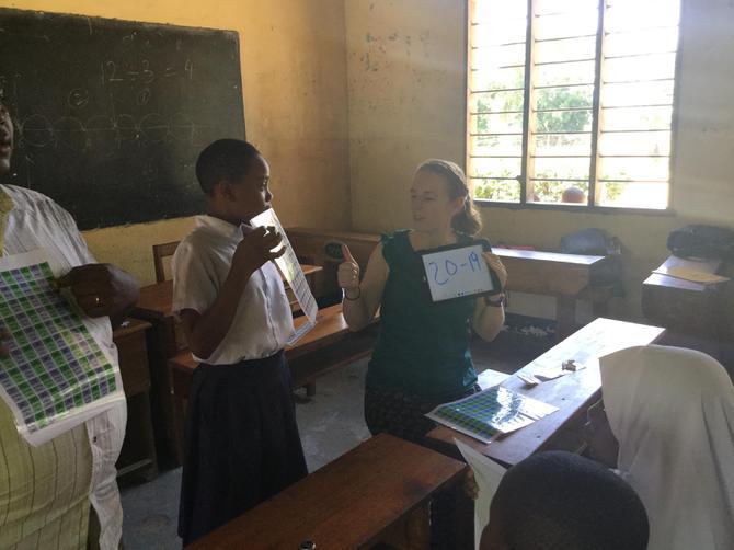 A child helping Mrs Allen learn Maths