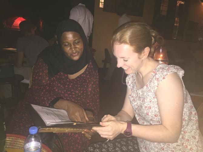 Mrs Allen and Madame Msemo looking at the menu.