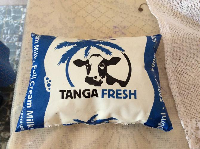 Milk is 200 Tanzanian shillings. (TZS)