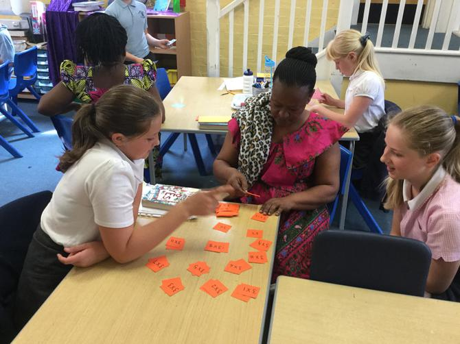 Madam Mrema playing Maths games in Y6.