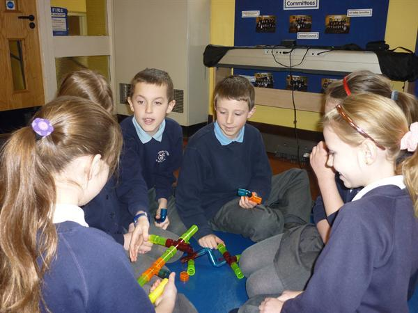 Working together to solve a variety of puzzles!