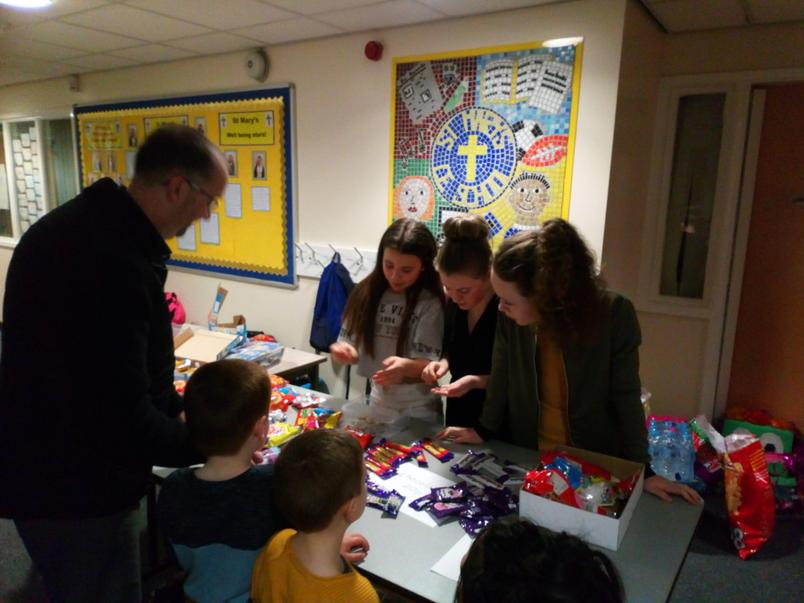 Year 6 selling the drinks and sweets to Nursery-Y2