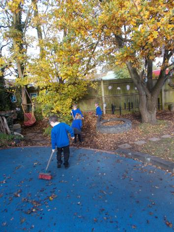 Sweeping the leaves to make a bed for the animals.