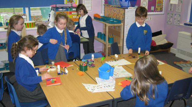 Children writing about what they have made.