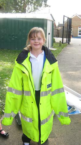 Trying on a PCSO's coat.