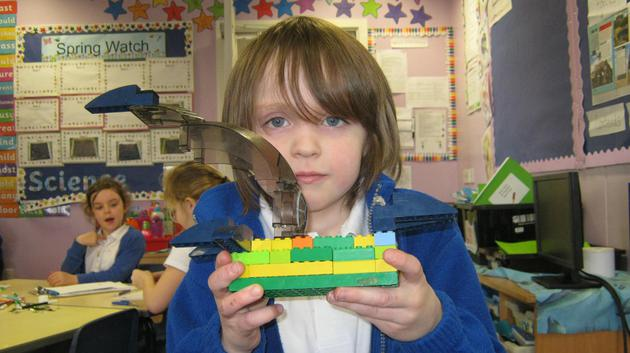Making a dinosaur out of Lego.