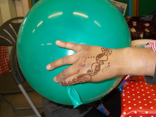 Crafts such as henna and balloons were on offer