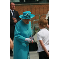 Ashton greets and hands flowers to The Queen