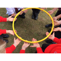 With just the tips of fingers, the children had to raise and lower the hoop