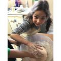 Abigail exploring cornflour slime.