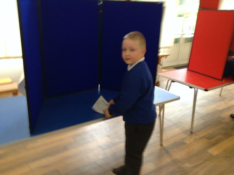 Y 1/2 casting their votes at the polling station