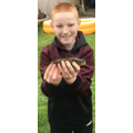 Archie in his garden with a fish?!
