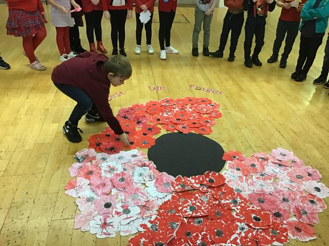 Each class created their own petals and laid them down to create one giant shared poppy.