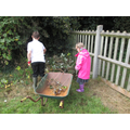 Some of the children, working hard weeding!