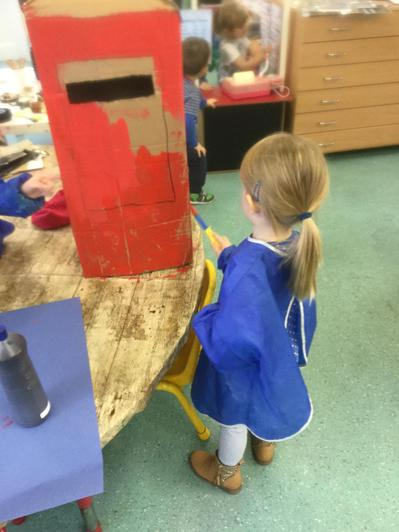 Painting the post box for our post office