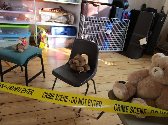 Bears, chairs, porridge and a red ribbon