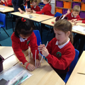 Using straws to create 3D shapes.