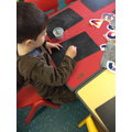 Chalking letter shapes on the chalk boards