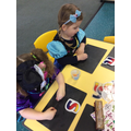 Copying letters on the chalk boards