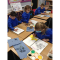 The children had sketched the pictures first.