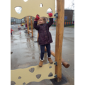 Exploring the new wooden equipment outside