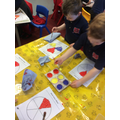 Using paint to mix the colours of the colour wheel