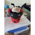 Hiding in the flower pot!