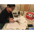 Priansh decorating his 100 Day t-shirt.