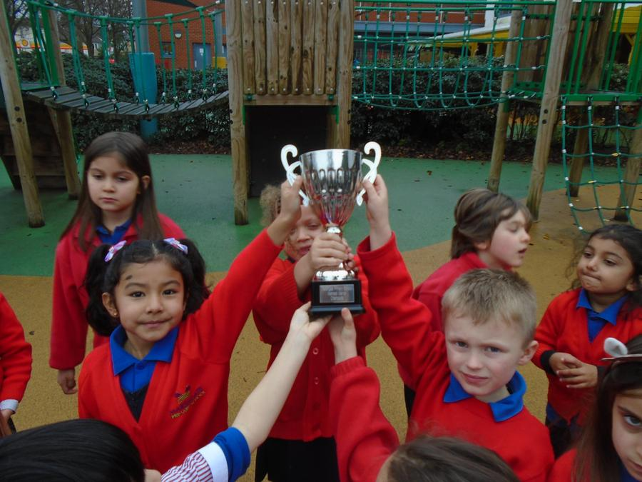 Tadpole Celebrate with the Trophy